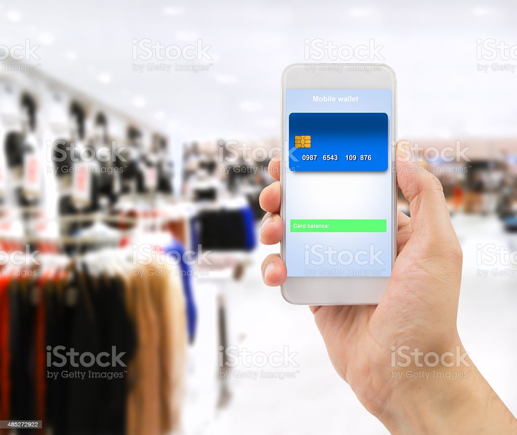 using the smartphone at the store to make payment stock photo