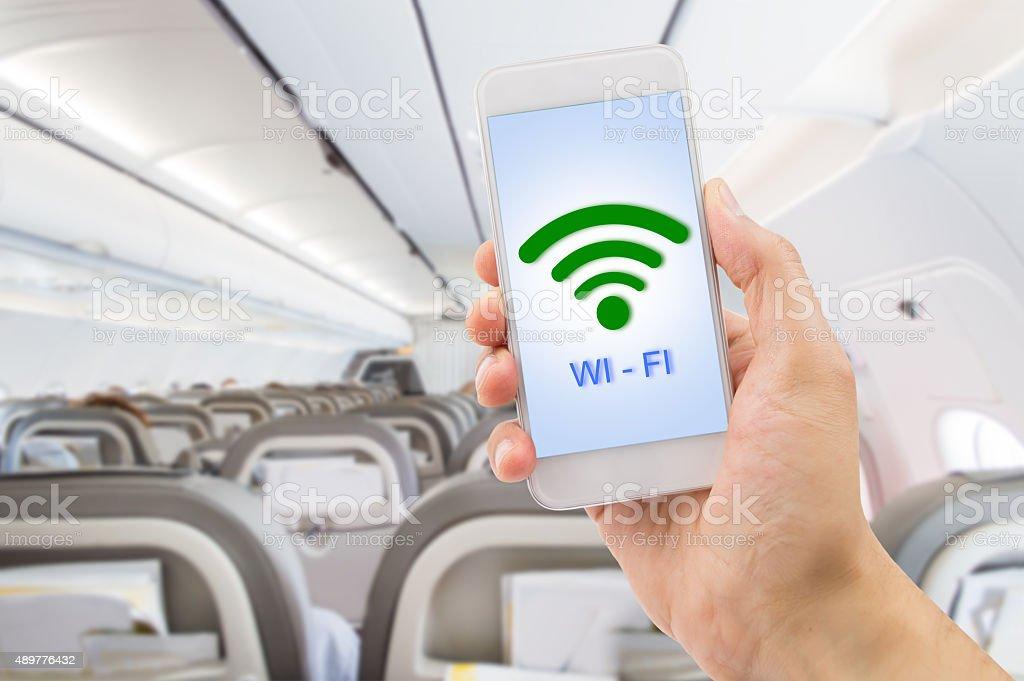 using the wifi at my flight stock photo