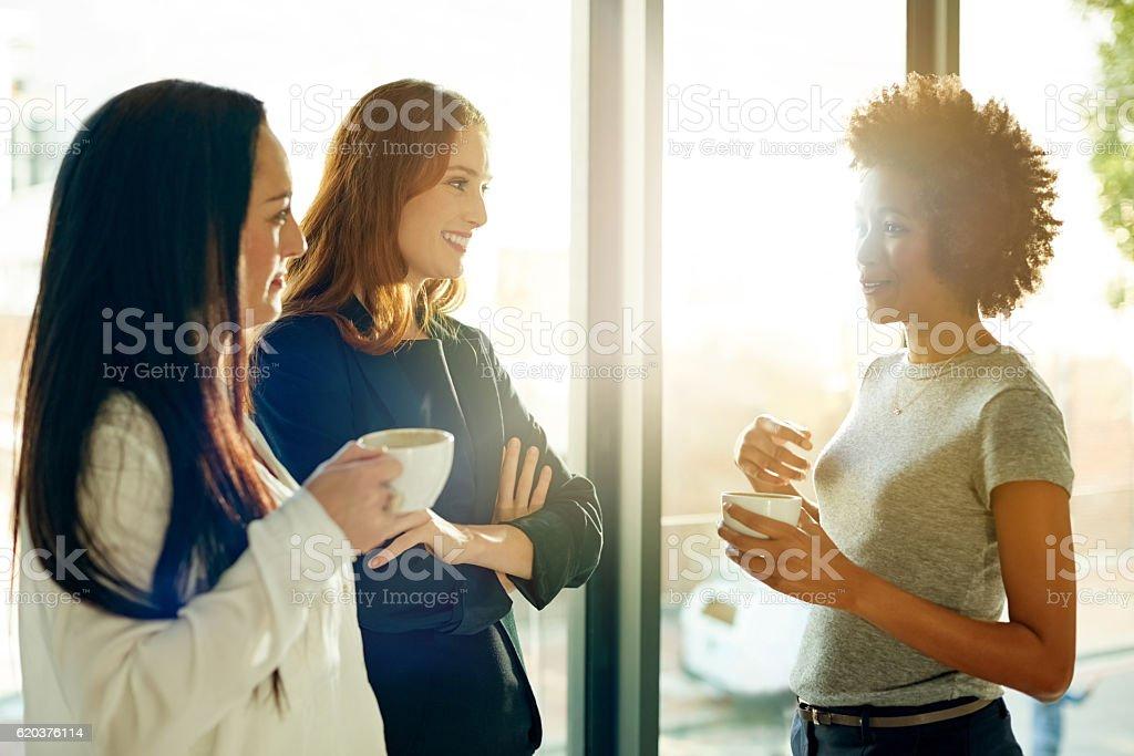 Using their tea break to catch up zbiór zdjęć royalty-free