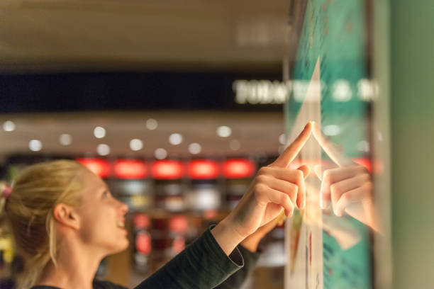 Using touch screen to find informations stock photo