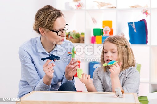 istock Using toys during play therapy 820615980