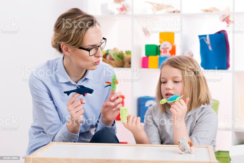 Using toys during play therapy stock photo