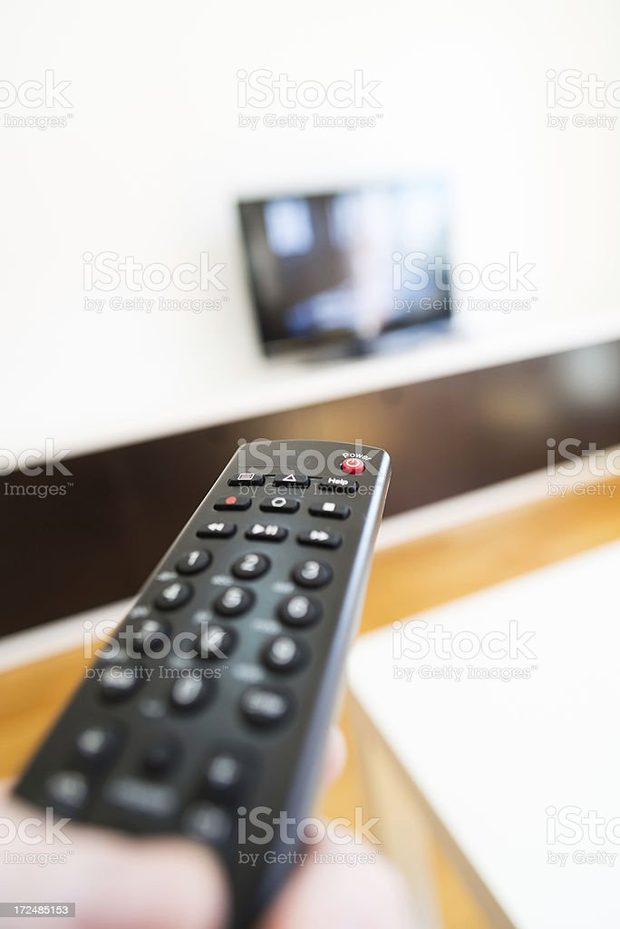 Using TV Remote Control royalty-free stock photo