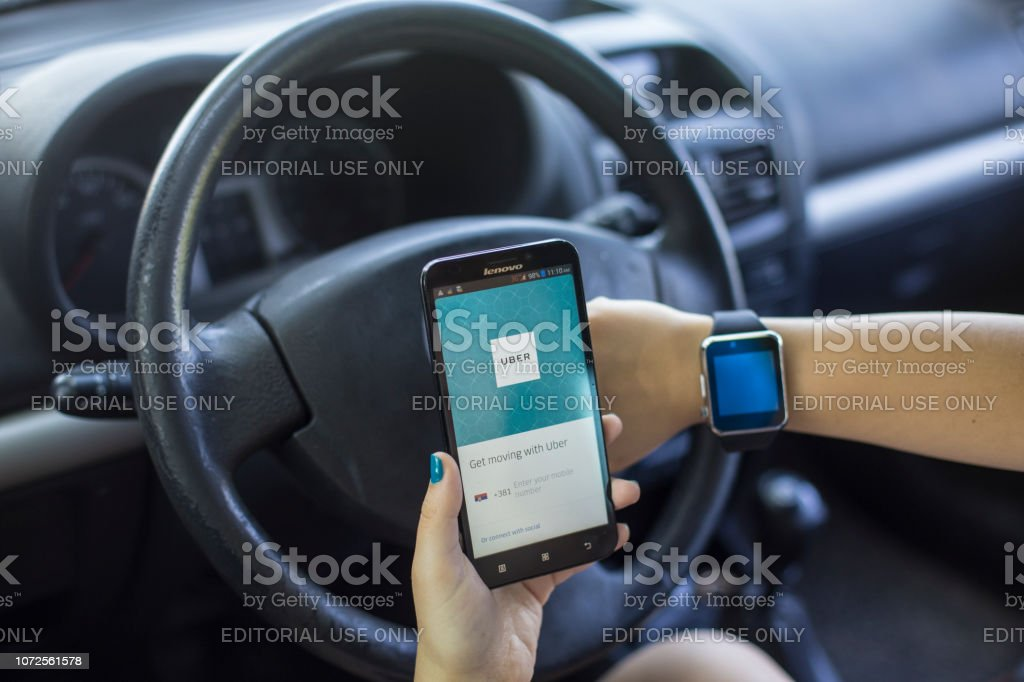 Using Uber app stock photo