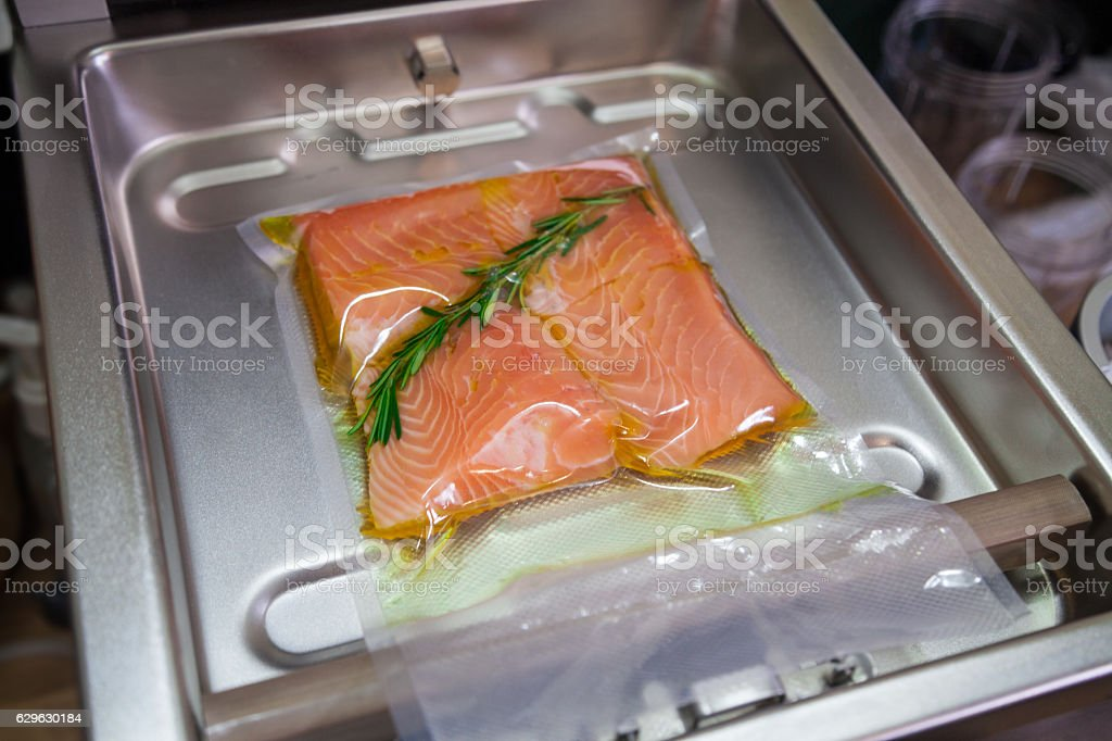 Using vacuum seal machine for sous vide. stock photo