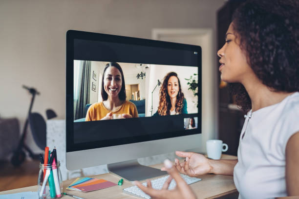 Using video and internet for business communication stock photo