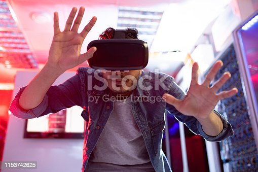 istock Using virtual reality simulator 1153742625