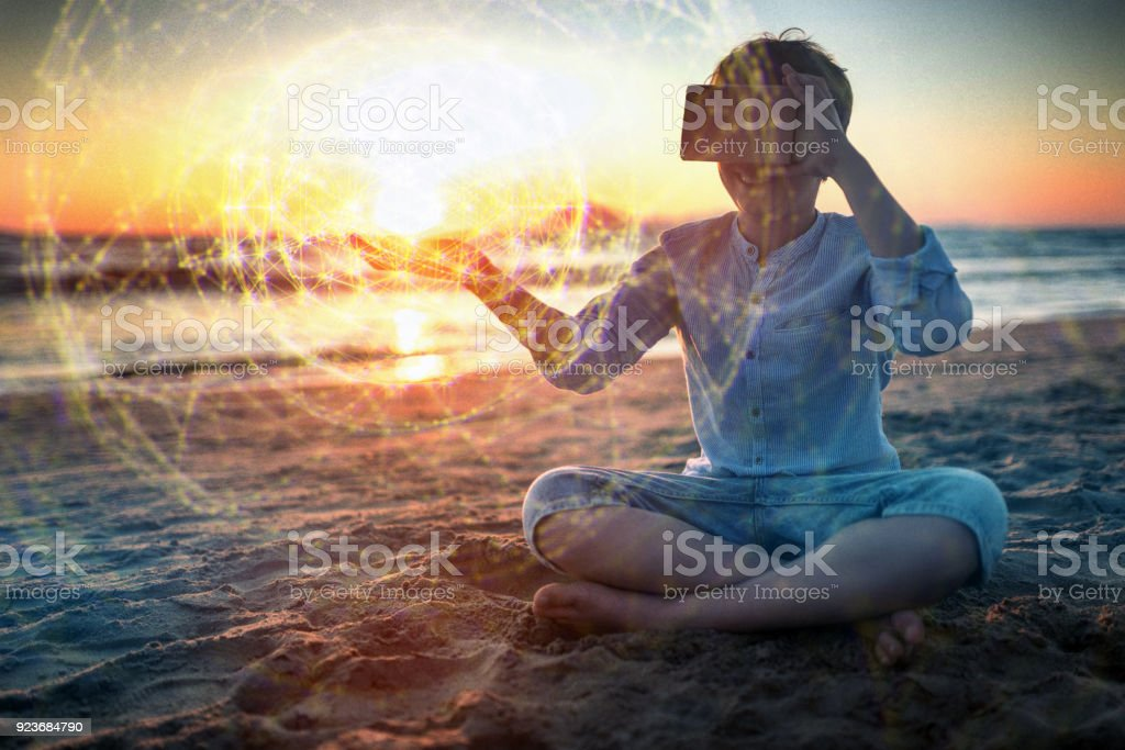 Using VR headset outdoors at sunset stock photo