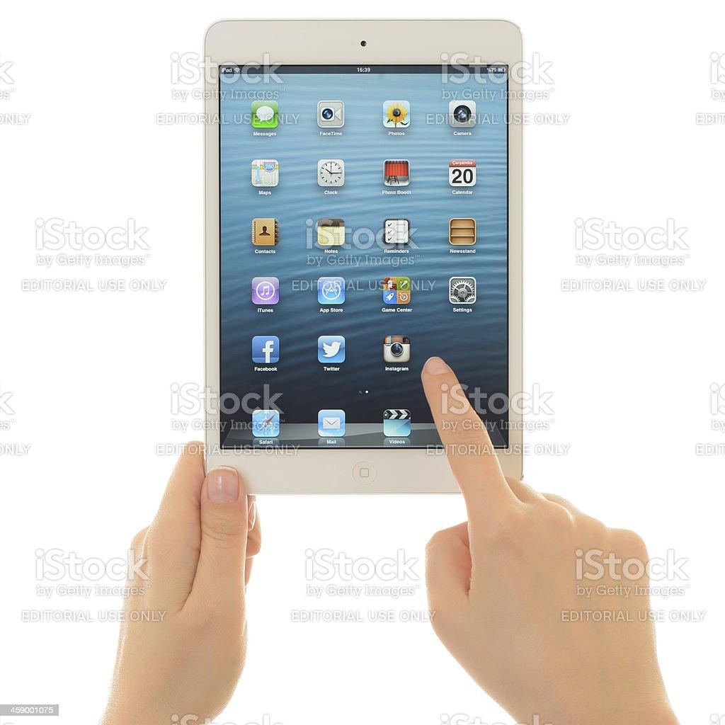 Using  white Apple iPad Mini royalty-free stock photo