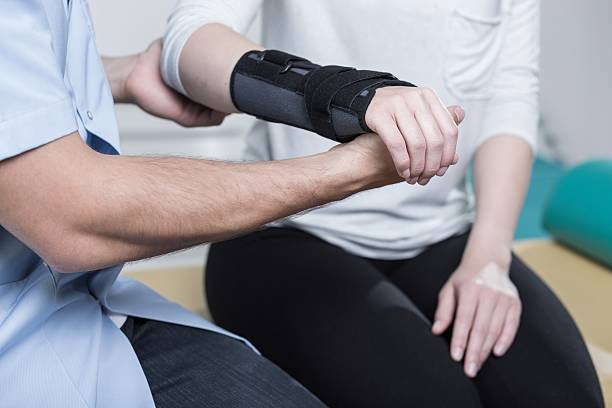 Using wrist immobiliser stock photo