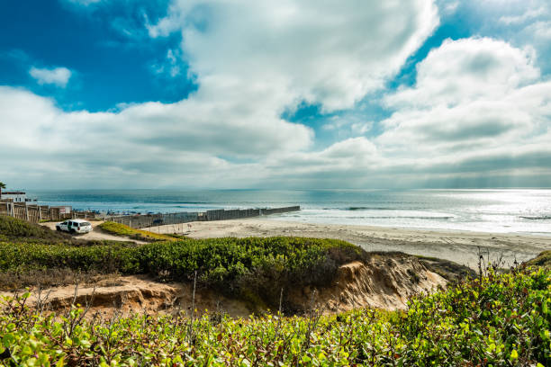US-Mexico Border at the Pacific Ocean stock photo