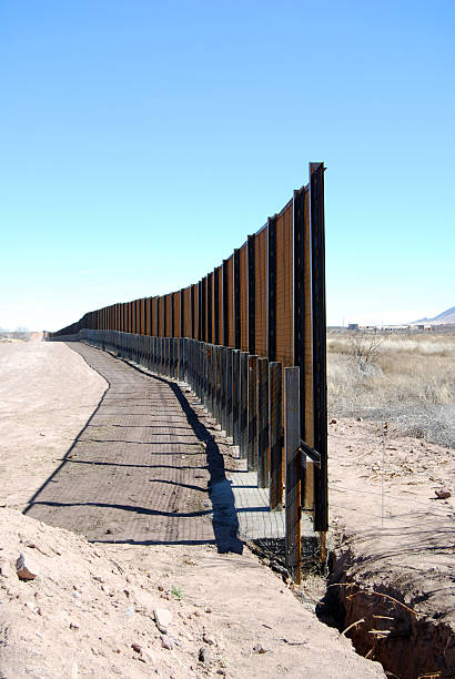 "US-Mexico border fence close-up ""Vertical close-up of Border fence under construction in Arizona (US to the left, Mexico to the right)."" international border barrier stock pictures, royalty-free photos & images"