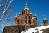 """""""Uspensky Cathedral with its golden cupolas in the Spring sunlight, a Russian Orthodox church, which is the largest Orthodox church in Western Europe, set against a bright blue Spring sky with snow in the foreground, Helsinki, Finland."""""""