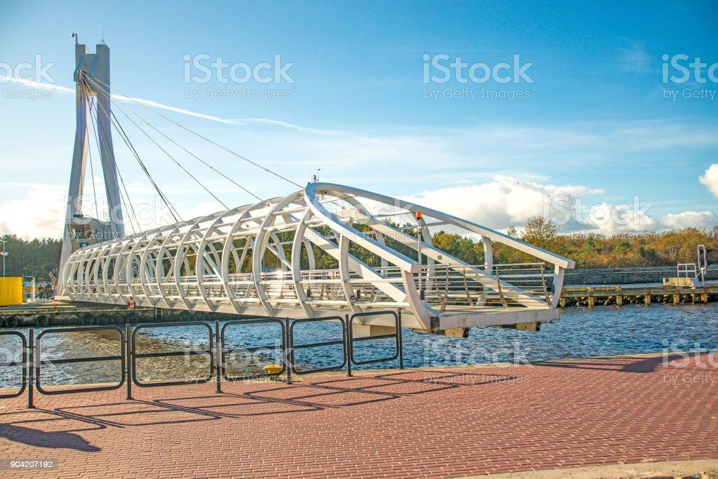 Ustka, modern swinging bridge over the port stock photo