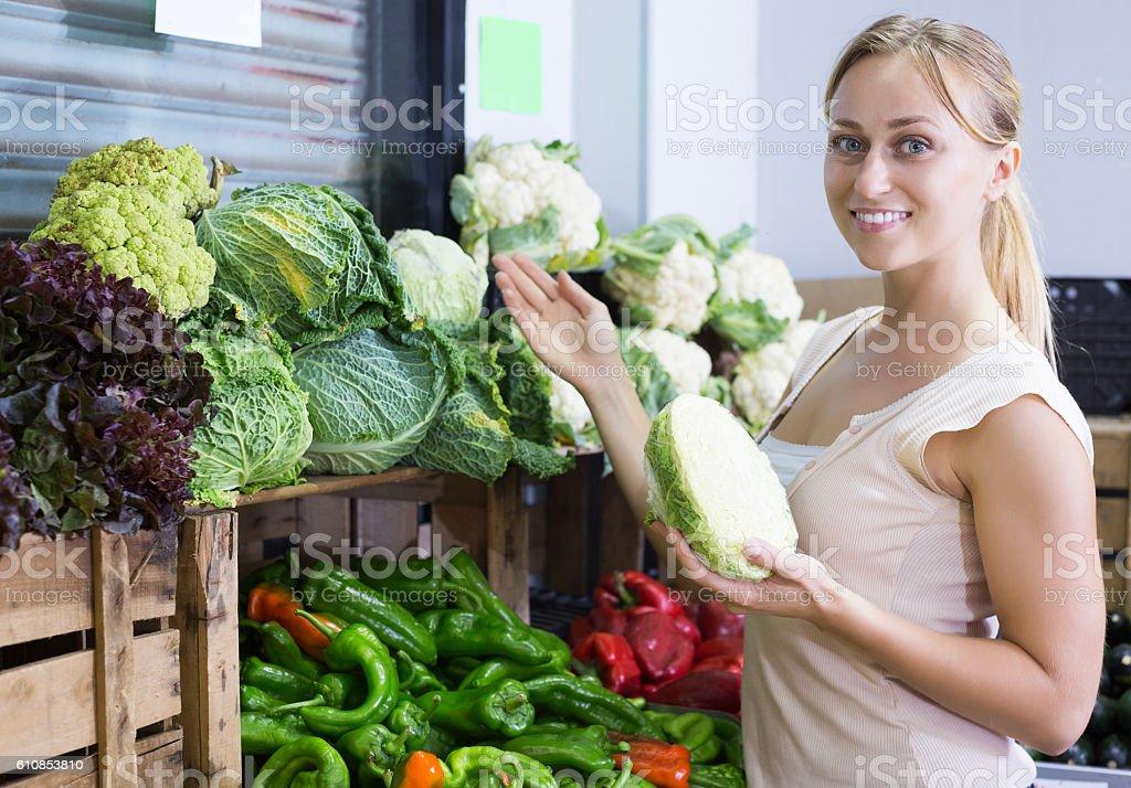 Ð¡ustomer choosing fresh cabbage stock photo
