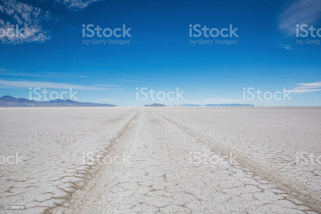Utah Bonneville Salt Flats SUV Car Tire Tracks Desert stock photo