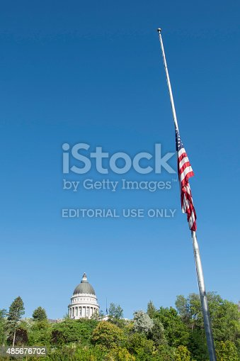 Salt Lake City, Ut, USA-july 23, 2015: Flag half mast in park with utah state capitol building in background