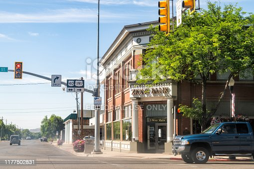 Vernal, USA - July 23, 2019: Utah city street with Zions Bank and cars on road in town near Dinosaur National Monument