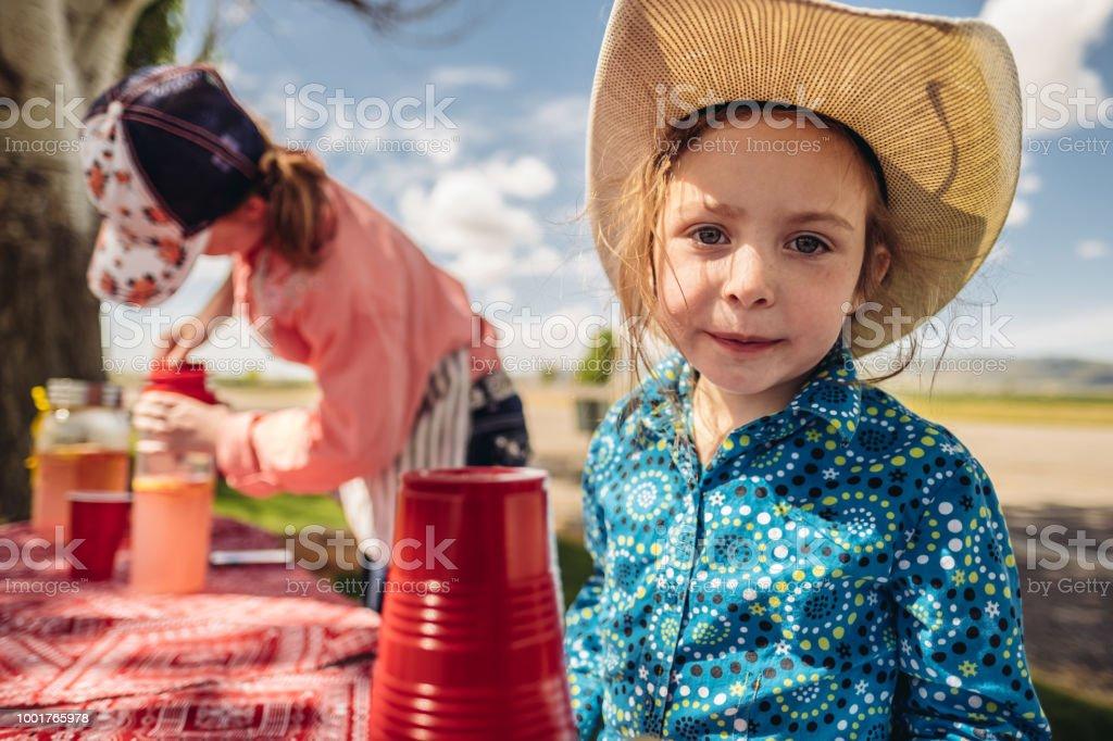 Utah cowgirl lemonade stand portrait stock photo