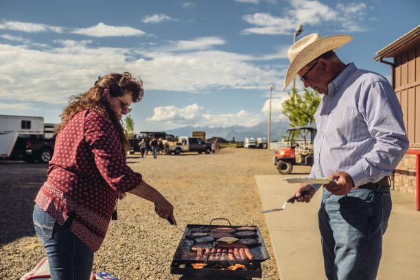 84d663d9bf603 Utah Rancher Family BBQ stock photo. modern cowgirl stock photo. Woman with  Head Down ...