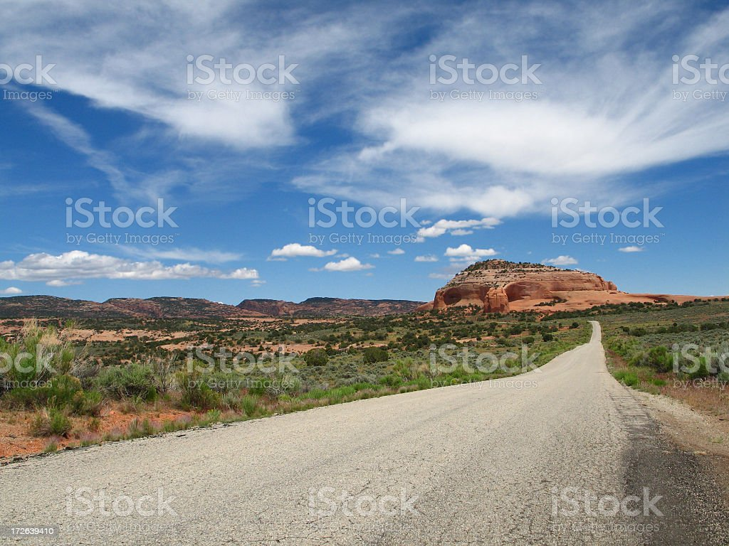 Utah Red-rock Landscape: Desert Road and Dramatic Sky royalty-free stock photo
