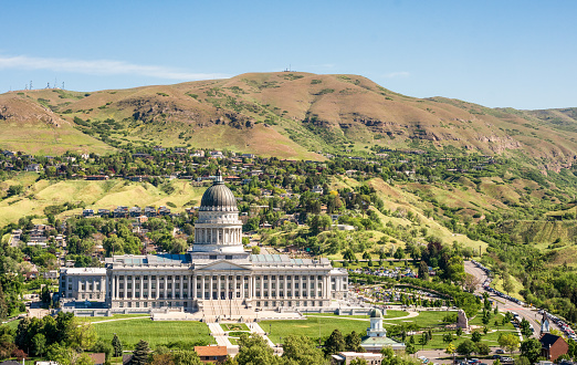 An elevated view of Utah's State Capitol building in springtime, located to the north of Salt Lake City center.