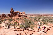 Tourists visit Turret Arch in Arches National Park in Utah. Arches NP was visited by 1,070,577 people in 2012.