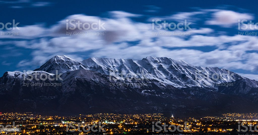 Utah Winter Mountains in Moonlight over City royalty-free stock photo