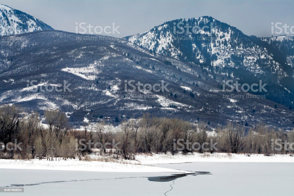 Utah winter mountains with aspen trees near Ogden Ski Resort in the winter stock photo