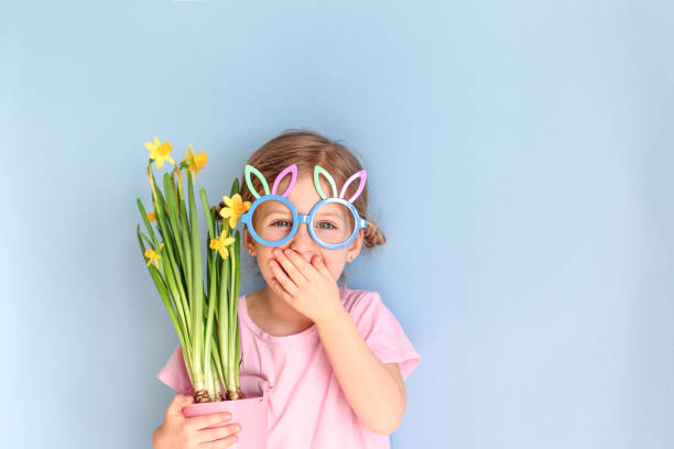 Ute little child wearing bunny ears glasses and holding flowers on picture id1138392105?b=1&k=6&m=1138392105&s=612x612&w=0&h=6zji1c5nl bu tmhkfdwbso3l1mh9xnsghdh1ibuxv8=