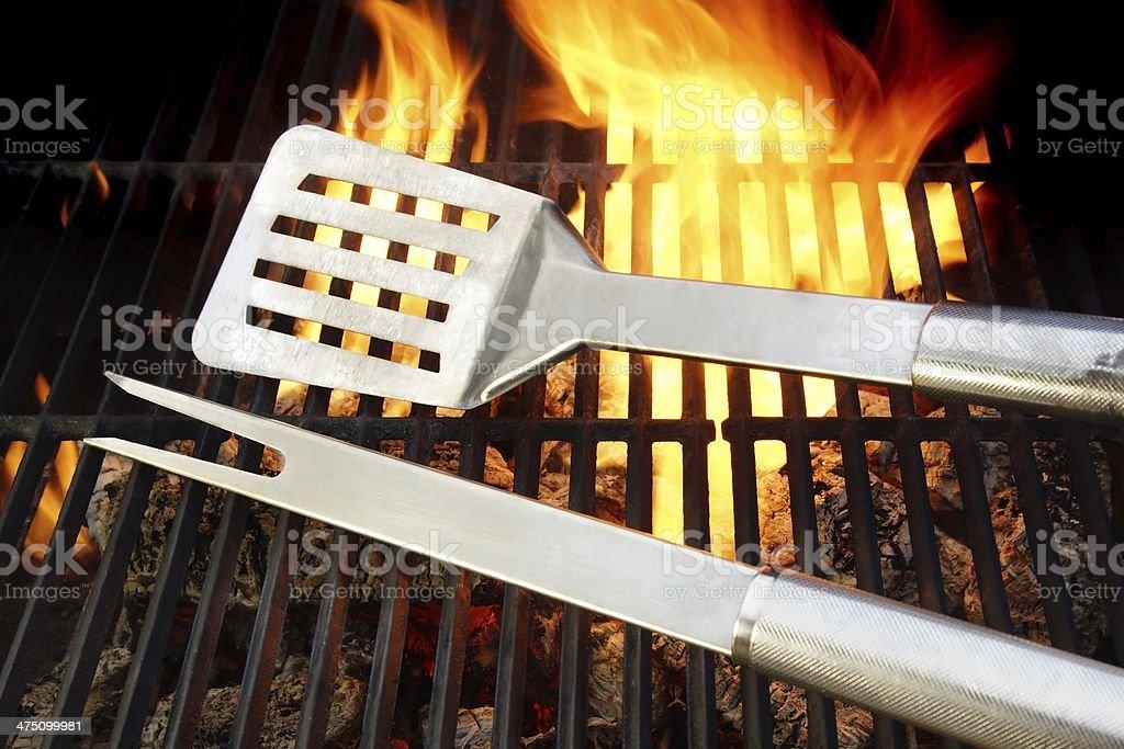 BBQ Utensils and Hot cast iron grate XXXL stock photo