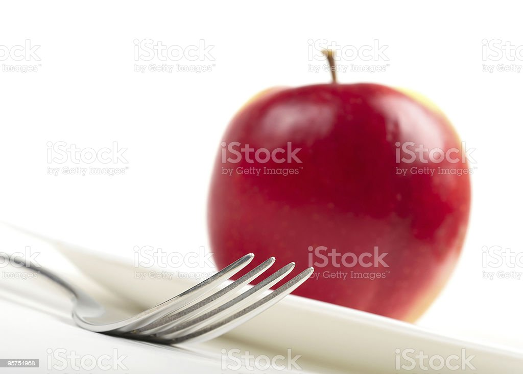Utensils and red apple royalty-free stock photo