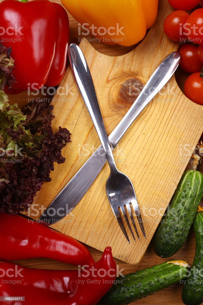 Utensils and vegetables royalty-free stock photo