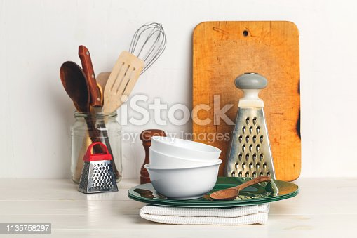 Utensils on a white table and a white background