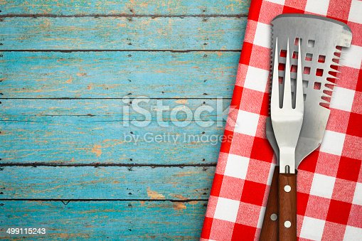 istock BBQ Utensils on Blue Rustic Picnic Table 499115243