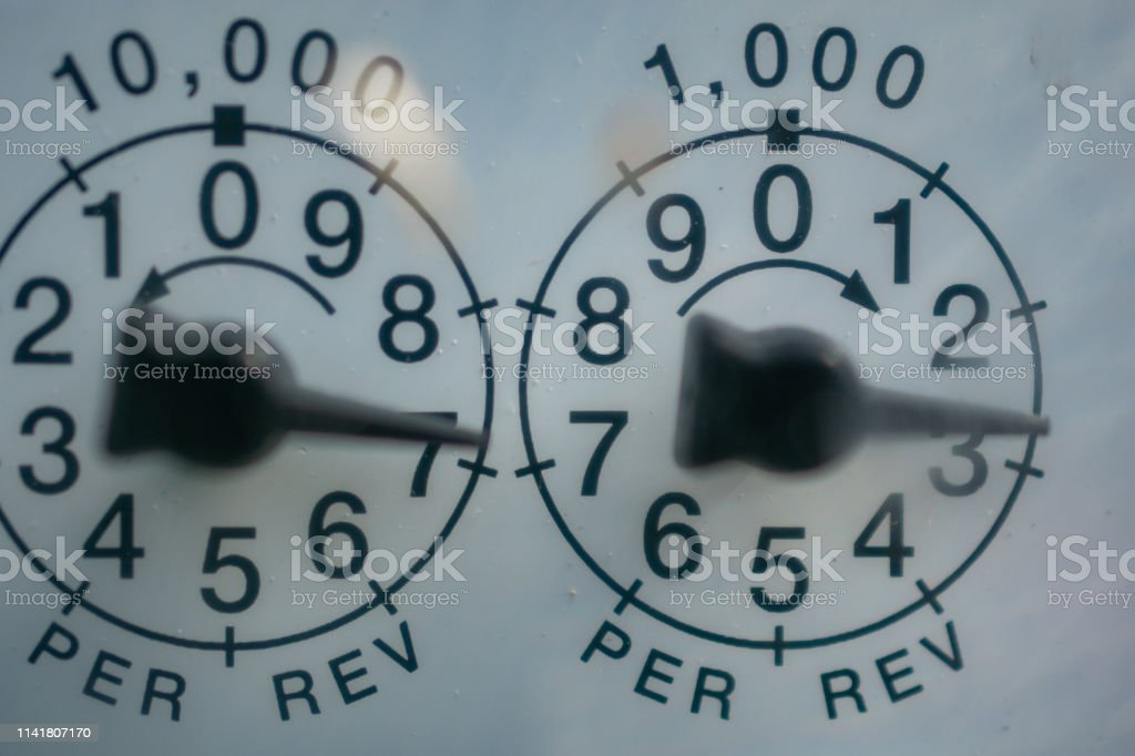 utilities meter dials stock photo
