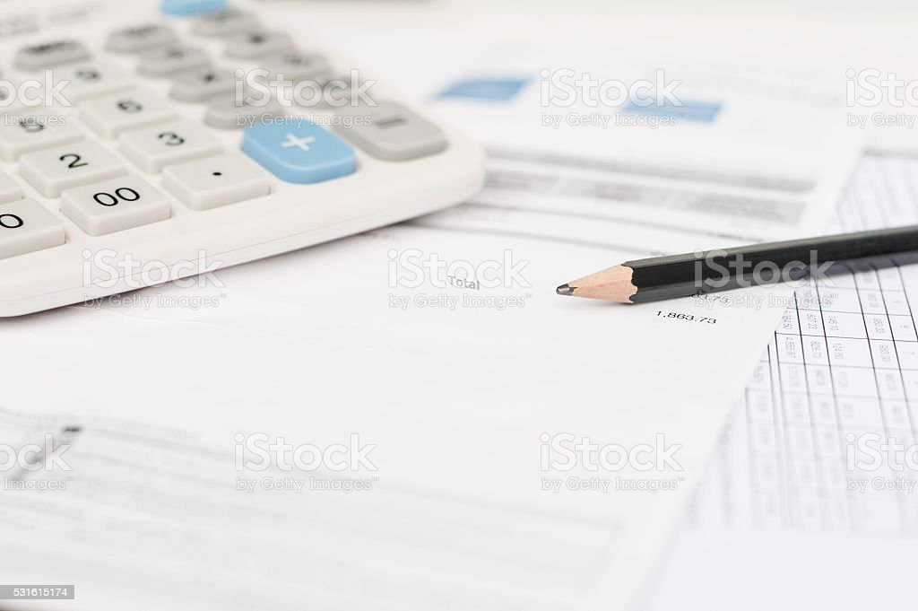 Utility bill and calculator stock photo
