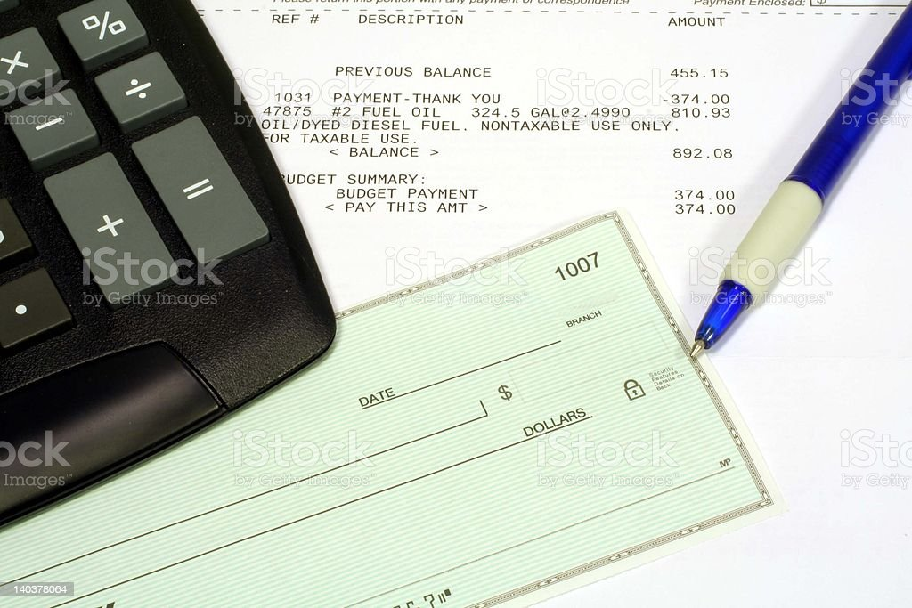 Utility Bill, Personal Check & Calculator stock photo