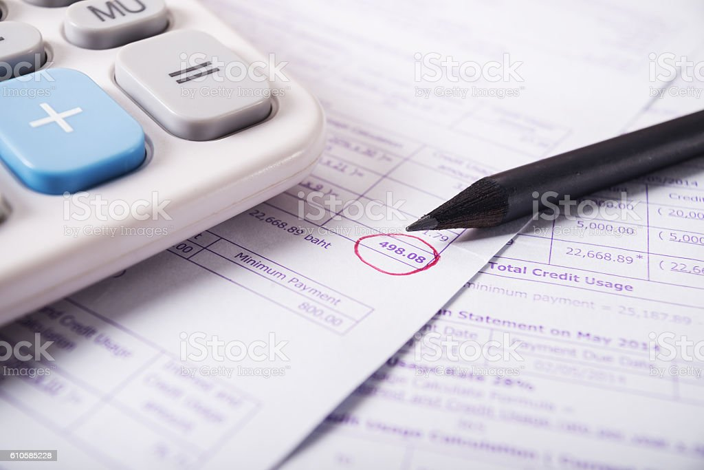Utility bill with calculator and pencil stock photo