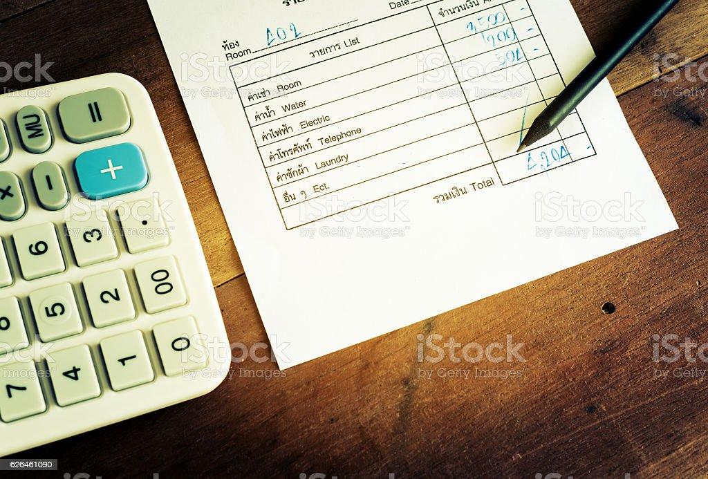 Utility bill with calculator and pencil, Save money - foto de stock