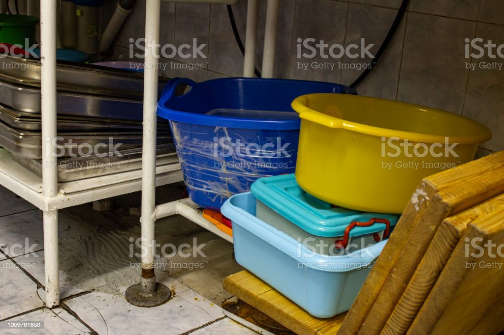 utility dishes washed in the dishwasher area, in the kitchen of the...
