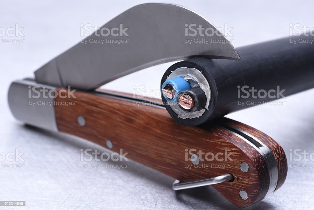 Utility knife tool with cable stock photo