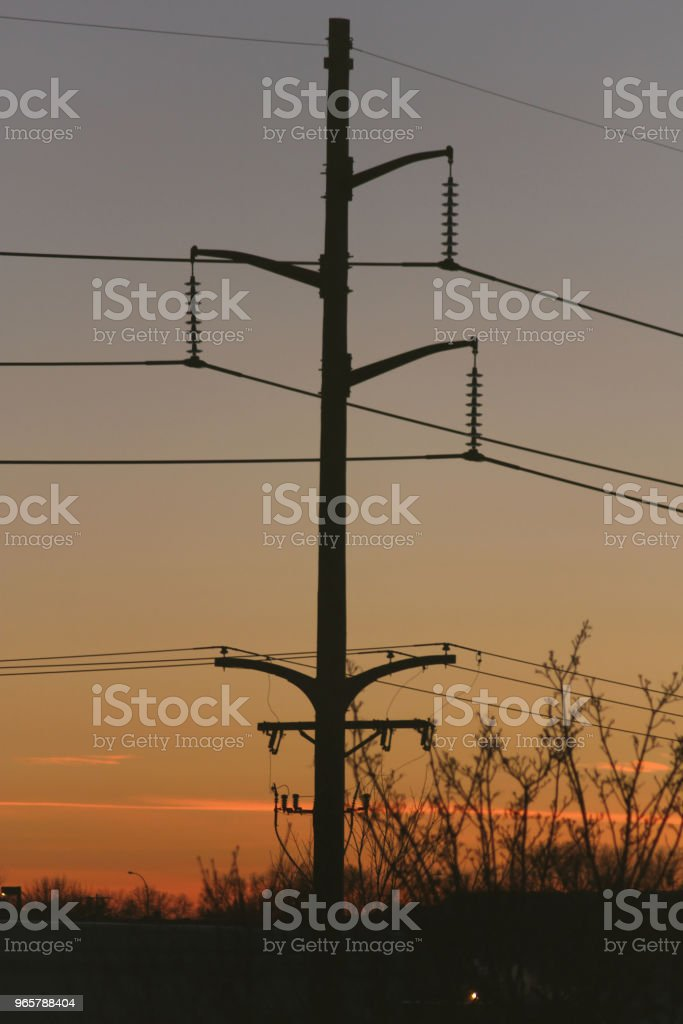 Utility pole in de schemering - Royalty-free Achtergrond - Thema Stockfoto