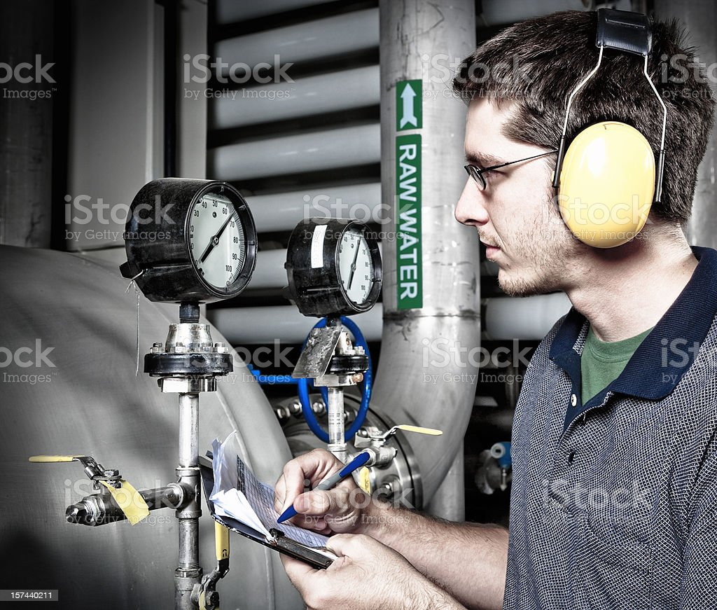 Utility Technician Documenting Readings at Water Plant stock photo