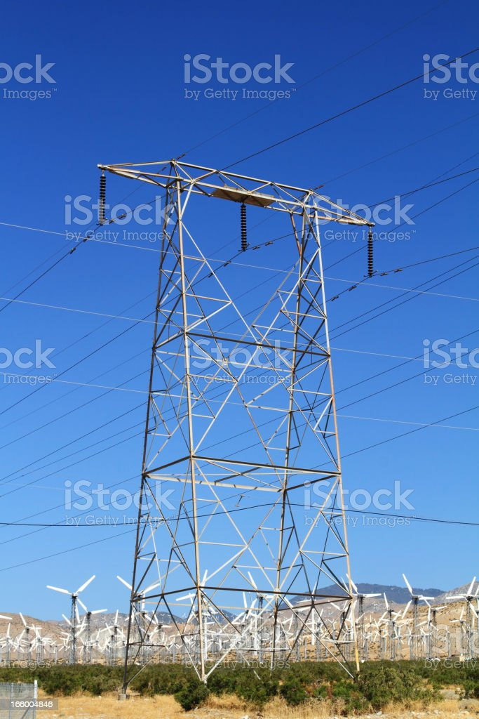 Utility transmission tower and Wind turbines royalty-free stock photo
