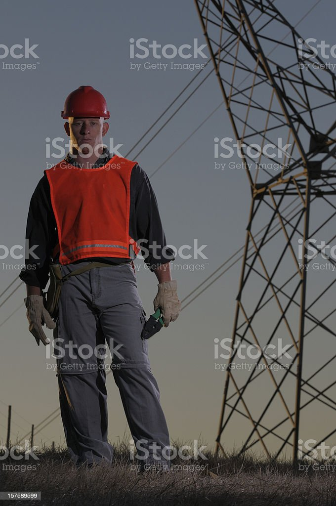Utility worker against power pylons mcu royalty-free stock photo