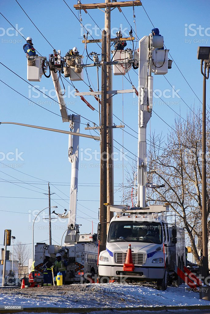 Utility workers fixing power pole stock photo