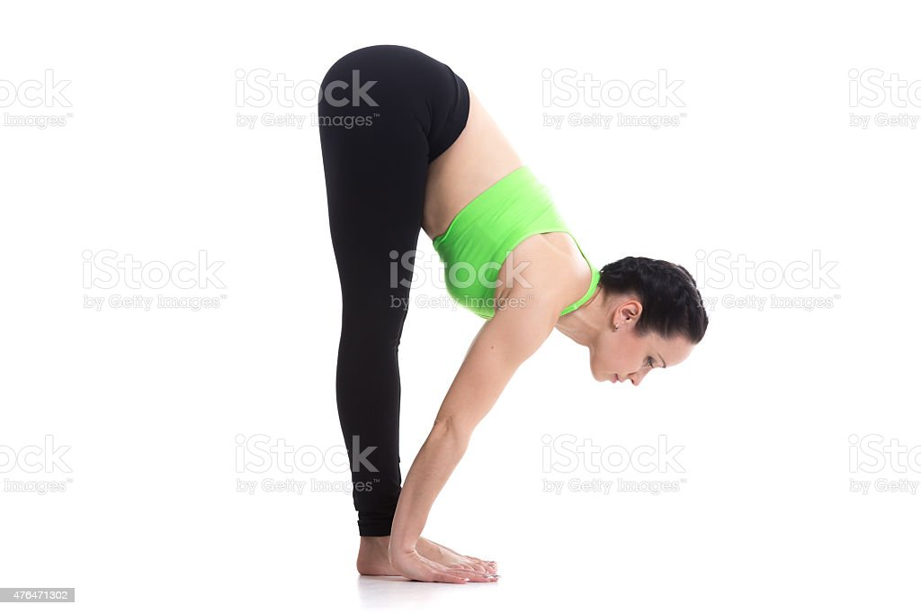 Uttanasana, intense forward bend yoga pose stock photo