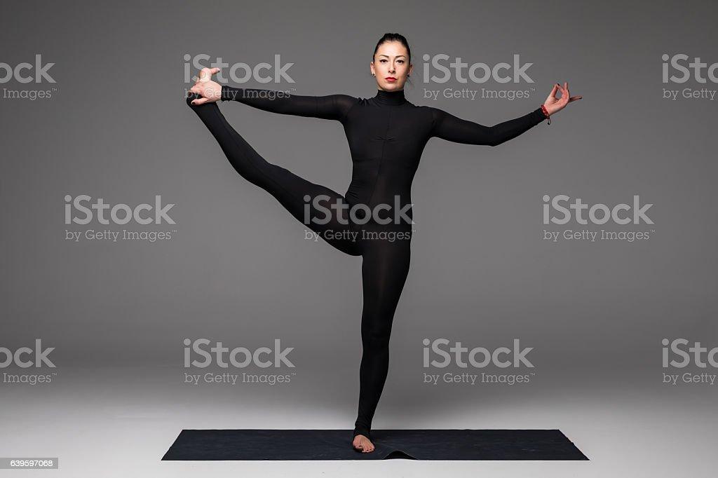 Utthita hasta. Beautiful yoga woman practice yoga poses stock photo