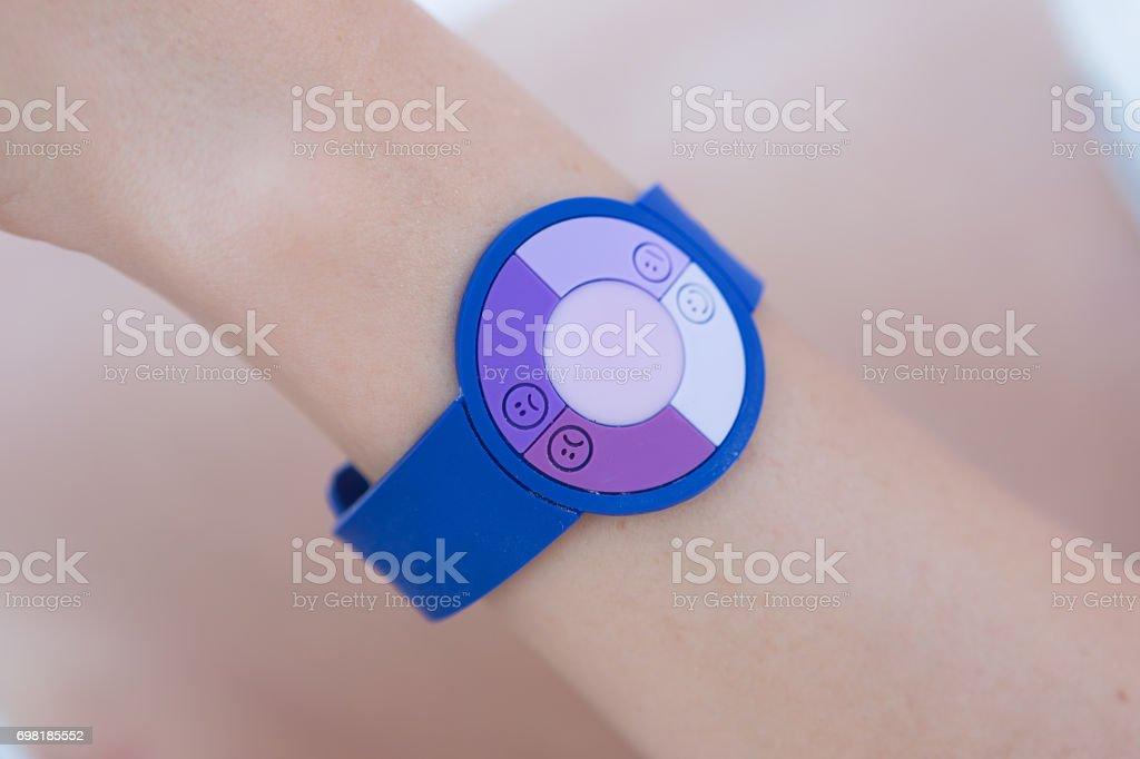 uv bracelet on woman`s hand stock photo